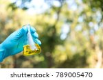 hand holding chemistry science... | Shutterstock . vector #789005470