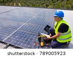 fitting photovoltaic panels on... | Shutterstock . vector #789005923