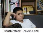 mood boy in book room. | Shutterstock . vector #789011428