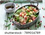 Stock photo winter salad with quinoa blood orange spinach avocado pomegranate hazelnuts and bulgur 789016789