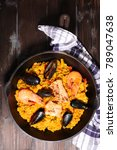 Small photo of spanish paella with seafood