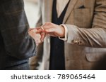 two men are exchanging rings on ... | Shutterstock . vector #789065464