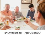 a table of male guests are... | Shutterstock . vector #789065500