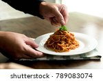 chef putting parsley on top of... | Shutterstock . vector #789083074