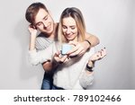 man makes present to his lovely ... | Shutterstock . vector #789102466