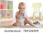 pretty baby boy drinking from... | Shutterstock . vector #789106909