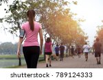 Stock photo group of people exercise walking in the park in morning 789124333