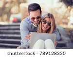 young couple watching a video... | Shutterstock . vector #789128320