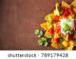 nachos loaded with salsa ... | Shutterstock . vector #789179428