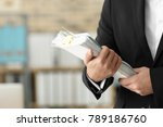 young man with documents in...   Shutterstock . vector #789186760
