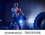 man with kettlebell weights... | Shutterstock . vector #789255358