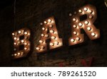 Light Bulb Glowing Letter. Tex...