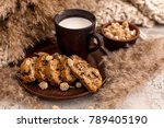 a cup of milk and crackers on a ... | Shutterstock . vector #789405190