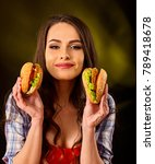 Woman Eating Hamburger.day Of...