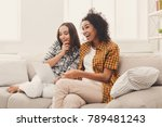 two happy female friends using... | Shutterstock . vector #789481243
