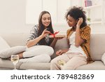 happy girls exchanging gifts.... | Shutterstock . vector #789482869