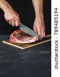 man cutting rack of lamb on...   Shutterstock . vector #789485194