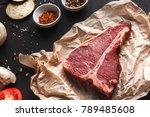 raw t bone steak on craft paper ... | Shutterstock . vector #789485608