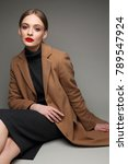 fashionable woman in a coat.... | Shutterstock . vector #789547924