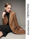 fashionable woman in a coat.... | Shutterstock . vector #789547933