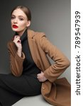fashionable woman in a coat.... | Shutterstock . vector #789547939