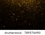 abstract gold bokeh with black... | Shutterstock . vector #789576490