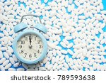 clock and pills on blue... | Shutterstock . vector #789593638