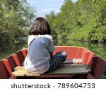 woman sitting in front of boat | Shutterstock . vector #789604753