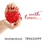 wicker red heart in woman's... | Shutterstock . vector #789624499