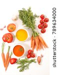 tomato and carrot soup on white ... | Shutterstock . vector #789634000