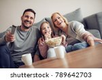 smiling young family watching... | Shutterstock . vector #789642703