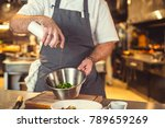 working cook in the kitchen | Shutterstock . vector #789659269