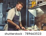 smiling cook in the kitchen | Shutterstock . vector #789663523
