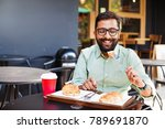 young bearded indian man eating ... | Shutterstock . vector #789691870