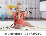 8 months age baby curious... | Shutterstock . vector #789739360