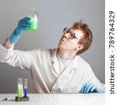 chemist scientist examines a... | Shutterstock . vector #789764329