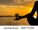 Small photo of Close up Silhouette hands. Woman do yoga outdoor. Woman exercising vital and meditation for fitness lifestyle club at the sunset beach background. Healthy Concept