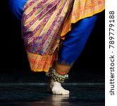 Small photo of Indian dancer, only legs cropped, Legs fragment photo of indian dancer. Woman from folk music group presenting traditional indian costume. Colorful indian costume