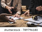 Small photo of Teamwork of business lawyer meeting working hard about legal regislation in courtroom to help their customer.