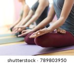 women practicing yoga together... | Shutterstock . vector #789803950
