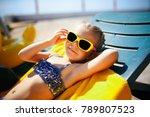 little girl in sunglasses is... | Shutterstock . vector #789807523