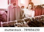 attractive girl deciding on... | Shutterstock . vector #789856150