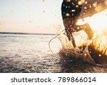 man surfer run in ocean with... | Shutterstock . vector #789866014