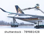 Small photo of DOMODEDOVO AIRPORT, MOSCOW, RUSSIA - 18 DEC 2017: The airliner Airbus A-350 XWB Singapore Airlines is in the process of the defroster before flight.