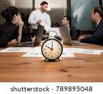 alarm clock on wooden table... | Shutterstock . vector #789895048