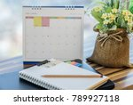 laptop with diary on wooden... | Shutterstock . vector #789927118
