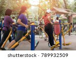 Woman Exercise In The Park Wit...