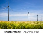 wind farms in barley fields | Shutterstock . vector #789941440