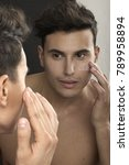 man putting on face cream... | Shutterstock . vector #789958894