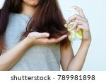 Small photo of Female and Coconut oil In Hand With treatment Hair Damage, Hair Damage, Health And Beauty Concept.